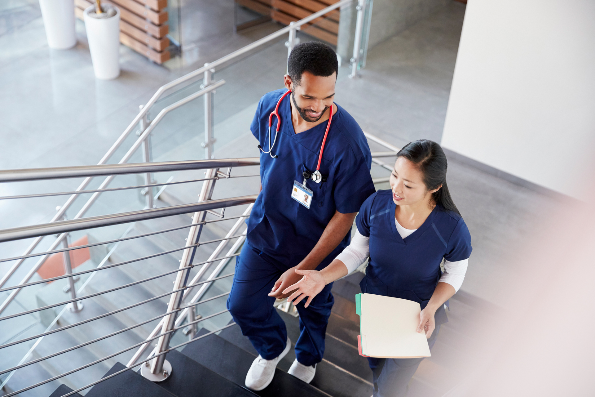 Two healthcare professionals walking up stairs